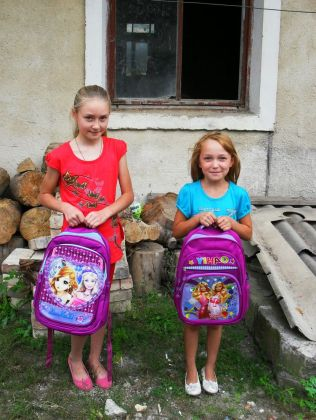 two-girls-received-schoolbags-filled-with-school-supplies